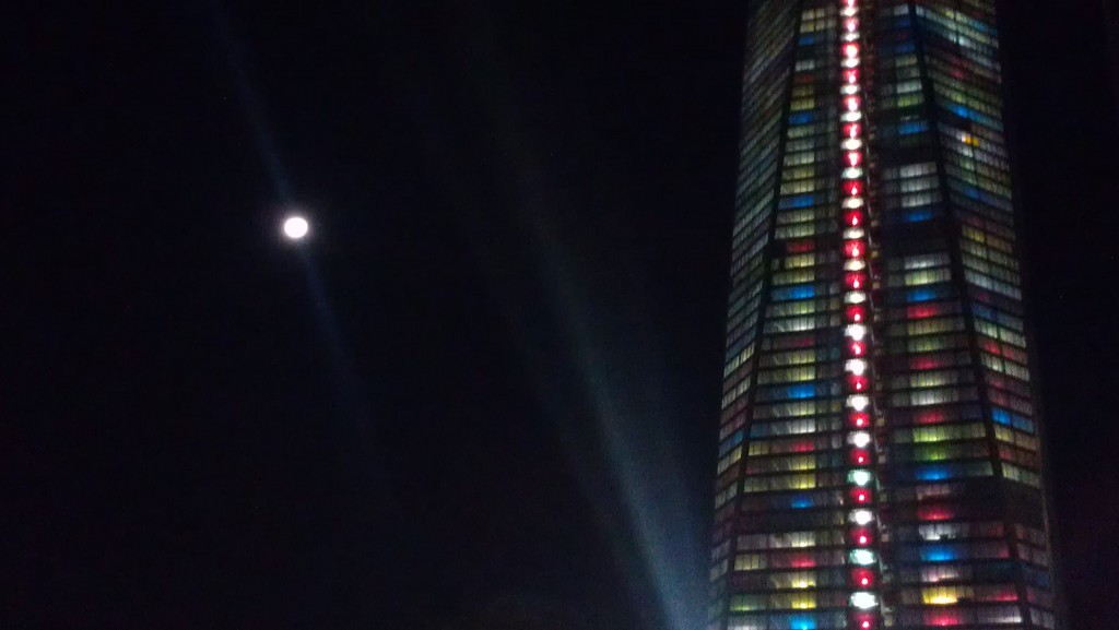Moon and World Trade Lit as a Christmas Tree