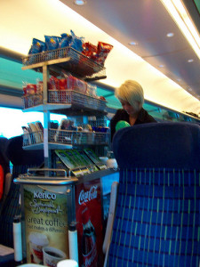 The snack cart & woman on the train.