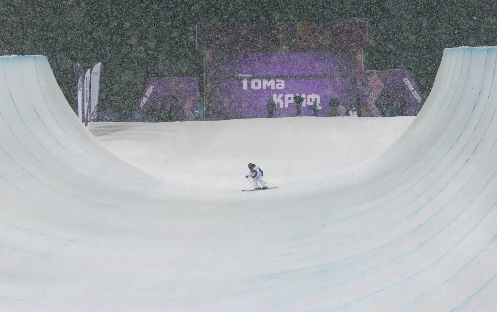 France's Thomas Krief slides during men's freestyle skiing halfpipe finals at 2014 Sochi Winter Olympic Games in Rosa Khutor